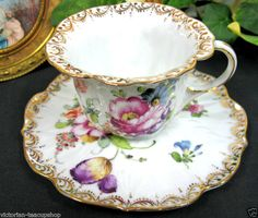 DRESDEN FLOWER SHAPE Handpainted  cup and saucer