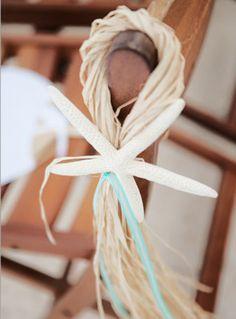 Starfish wedding detail, ceremony chair decor | Photo: Chris Joriann Photography