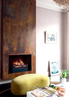 17 Modern Fireplace Ideas to Instantly Upgrade your Living Room Interior - Decorate Your Home Industrial Fireplaces, Metal Fireplace, Home Fireplace, Living Room With Fireplace, Fireplace Surrounds, Fireplace Design, Fireplace Ideas, Distressed Fireplace, Contemporary Fireplaces
