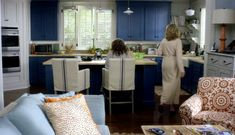 Grace and Frankie Beach House {Photos and Inspiration!} - Hello Lovely - Grace and Frankie beach house kitchen with blue cabinets and barstools. Grace Kitchen, Blue Kitchen Cabinets, Kitchen Stools, Navy Cabinets, Navy Kitchen, Mini Kitchen, Kitchen Shelves, Counter Stools, Bar Stools