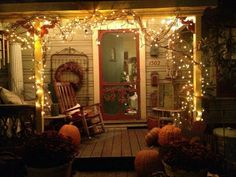 I love all the lights on this fall porch! It reminds me of something off of Bewitched.