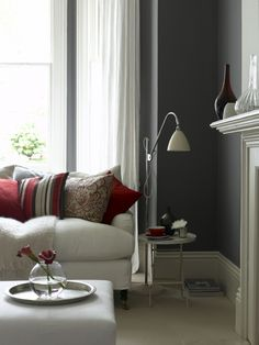 Classic living room in contemporary dark grey and off-white with red accents