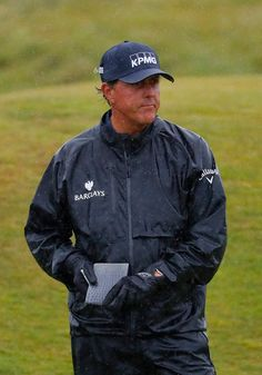 Two gloves for Phil Mickelson. It worked. He holds the lead at The Open Championship. Phil Mickelson, Sports Figures, Bomber Jacket, Lol, Gloves, Laughing So Hard, Bomber Jackets, Mittens