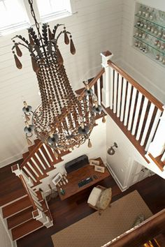 """So much to love here. Chandelier.  View is from third looking down to second floor landing (build upward when footprint is small!). Love the sand collection tucked into """"shared space,"""""""
