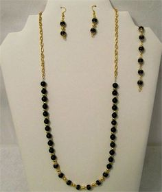 Black and Gold 28 Necklace, Bracelet and Earring Set, USA Made,    This set will come in a gift box ready for you to give.   Sports Team set- Can you guess which one? Louisiana team.   This is a 28 long necklace so would look great worn with a tee shirt or sweater when you attend those games or just to show your support any time.   Some of the black glass beads have gold bead caps and also has gold spacers, Beads are 8mm and they are mounted on a gold chain and it closes with a lobster…