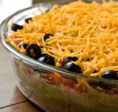 Debi's Tex-Mex Layered Dip Recipe - This is one of my standby recipes that I take to potlucks or serve when we're hosting a Game Night for friends and family at our house. It's always a huge hit … and never any leftovers! #debihough