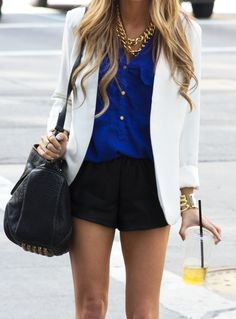 Royal blue blouse with white blazer and gold accessories.