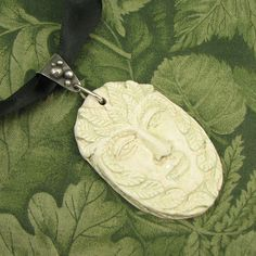 Cream colored Green Man Pendant with Sterling Bail - OOAK by marybird on Etsy