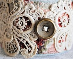 Pretty vintage lace, fabric and button.