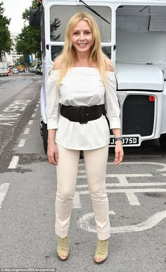 Glamorous: Carol Vorderman was on her typical fine form as she headed out on the organisation's double decker bus to collect nominations from the public on Thursday