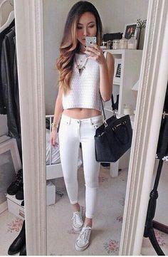 White crop top. White jeans. White converse. Black handbag. Statement necklace.