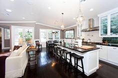 Open kitchen Remodel - tear down wall to Family Room and open dining room up for more open feel?