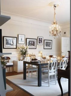 pictures staggered on dining room wall