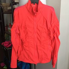 Zella Plus Jacket Gorgeous bright color. Hard to explain, I wouldn't call it orange or red or pink. It's this bright pinky orangey reddish LOL. Exercise zip up with mesh detailing for a little sexy. Gently worn and in great condition. Zella Jackets & Coats