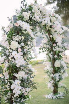white flower wedding arch