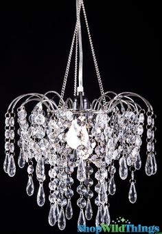Add some bling to your life with this iridescent beaded chandelier that's petite yet packed with luxury. This chandelier can also be used as a centerpiece lamp by placing it on a tall vase. Acrylic Chandelier, Beaded Chandelier, Chandeliers, How To Make A Chandelier, Crystal Wind Chimes, Door Beads, Vase With Lights, Waterfall Fountain, Beaded Curtains