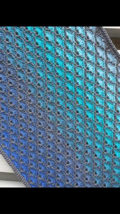 Gradient shawl This shawl is made with inspiration from Jellina-creations pattern Olivia cowl The shawl is made with two different kinds of yarn to create a beautiful effect. You have to cut the ya…