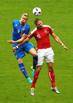 #EURO2016 Kolbeinn Sigthorsson of Iceland challanges Sebastian Proedl of Austria during the UEFA EURO 2016 Group F match between Iceland and Austria at Stade...