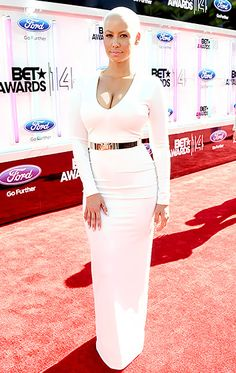 Amber Rose went stylish and simple at the 2014 BET Awards, wearing a V-neck long-sleeved white gown.