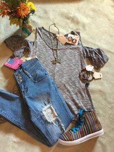 HIgh rise jeans with stretch and lift! nice fall transition top with open shoulder serape high tops Livestock necklace  serape bracelets. All available on our website and thru pinterest using the pinterest app