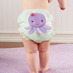 """Leave it to Baby Aspen to prove that seersucker, stripes and sea life belong together! The 3-D details on a friendly fish, a cute crab an outgoing octopus--all in splashy colors--make these beach-happy bloomers fun to wear! 