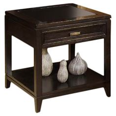 Showcasing a beveled glass mirror top and 1 drawer, this handsome side table is a perfect addition to your living room or den.   Pr...