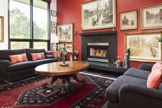 Awesome Family Room Wall Picture Design Ideas with Red Walls Paint Color and Large Rugs under Oval Table Also Using Glass Window