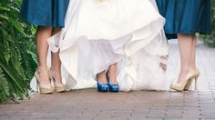 Bride wearing Blue Satin Steve Madden Wedding shoes to match the color of her bridesmaids dresses