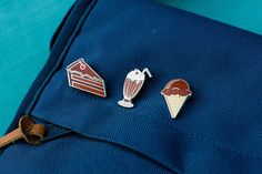 Chocolate Lovers enamel lapel pin set on blue canvas bag
