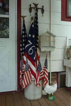 Bucket with flags front door, indoor decor