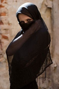 Woman with a black veil.