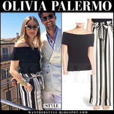 Olivia Palermo in black off shoulder top and stripe black and white pants