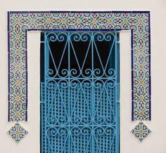 tunisian tiles and wrought iron railings