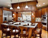 The backsplash is intriguing, and the cabinets over the island are interesting...