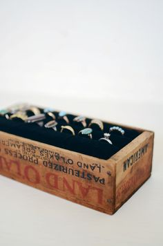 love this diy wooden ring holder in vintage land o'lakes butter box. would be cute hung up on the wall too.