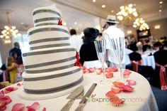Silver ribbons on topsy turvy wedding cake