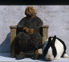 Arne Ranslet The grandmother in Stoneware. A similar sculpture was made in Bronze. Next to it is the Pet rabbit Figaro who like all the pets were models for Sculptures and Paintings. (Pharyah)
