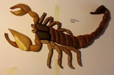 Scorpion Wood Intarsia 16x10 inches. 4 different wood. Mulberry, ash, sapele, walnut. Background: Black painted birch plywood Finishing: Natural wood wax.