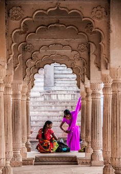 A woman adds the finishing folds to her sari while her friend looks on at Pushka. - A woman adds the finishing folds to her sari while her friend looks on at Pushkar Lake, India - Visit India, India Art, Rajasthan India, Indian India, World Photography, Travel Photography, Indian Photography, Bollywood Stars, Viajes