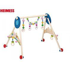 Confortablement installé sur son tapis d'éveil, bébé doit avoir les jouets du portique au-dessus de lui au niveau de son torse. A partir de 3 mois, il commencera à vouloir les attraper. Installez bébé dans son transat, et placez le portique de manière à ce que les jouets soient placés au niveau de son ventre. Ainsi, il pourra plus facilement les attraper. Le portique permettra à votre enfant d'éveiller ses sens. Walking Horse, Jouer, Fit, Hanger, Packaging, Learning, Toys, Transportation, Germany