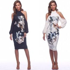 Clover Sleeve Midi. A beautiful midi by Pasduchas. A high neck style featuring cut out shoulders and floral print.
