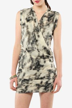 Wish this was in some crazy bright color instead of cream/white. Right now it looks like mold, but I like the cut. $385