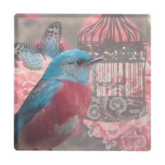 Vintage Blue Bird Design with bird cage and butterfly surrounded by pink flowers.