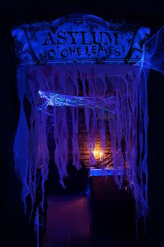 I like the idea of the guaze hanging at the entrance with a blacklight.