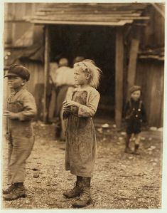 Bertha, one of the six-year old shuckers. Began work at 4 A.M. Maggioni Canning Co. Location: Port Royal, South Carolina Feb 1912 Lewis Hine photo