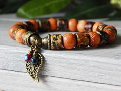 Popular boho leaf bracelet made Robles Wood and a Matte Ceramic Autumn Mixed Rondelles it has an antique bronze Leaf Charm with two tiny handmade charms. Jewelry Shop, Beaded Jewelry, Handmade Jewelry, Jewelry Design, Beaded Bracelets, Jewellery Diy, Bronze Jewelry, Tribal Jewelry, Bohemian Bracelets