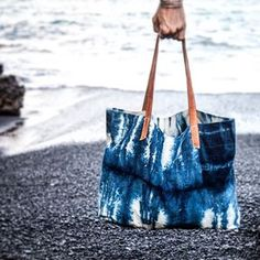 #shibori #beach #bag #handbag #beachwear #beachbag #totebag  #handmade #duckcanvas #canvas #indigo #leather We've remastered the ancient Japanese technique of Shibori dyeing for this handmade tote bag. Perfect for trips to the beach or the farmers market. Check out more at schindlereddydesign.com