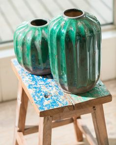 A striking decorative vase in rustic earthenware with a beautiful emerald green glaze. The textured form has a pleasing organic simplicity. The finish is deliberately distressed to add texture and variations in colour, so imperfections are to be expected as part of the style.