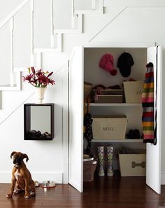 That extra space under the stairs could easily become a cluttered mess. But attractive baskets keep things hidden away.