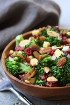 Super Healthy Broccoli Salad recipe is a twist on a classic with yogurt, pepitas, chia and hemp seeds. Everyone gobbles this salad up and loves the crunch.